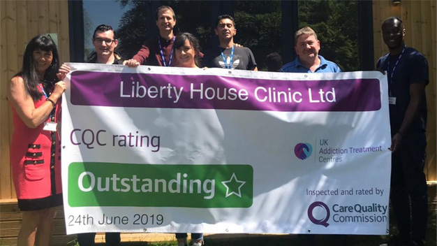 liberty house team holding cqc result banner